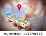 hand held phone with gps or... | Shutterstock . vector #1063786583