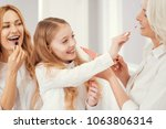 try this one. excited three... | Shutterstock . vector #1063806314