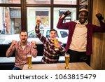 men at the pub watcing football ...   Shutterstock . vector #1063815479