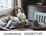 cozy summer morning at rustic... | Shutterstock . vector #1063827149