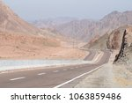 road and mountain landscape ... | Shutterstock . vector #1063859486