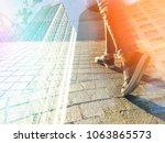 close up feet step up toward... | Shutterstock . vector #1063865573
