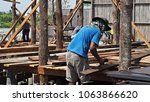 construction workers cutting...   Shutterstock . vector #1063866620
