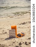 Small photo of Vintage photo, Medical pills, carrot juice and sunglasses at beach, concept of prevention of vitamin A deficiency, beautiful and lasting tan