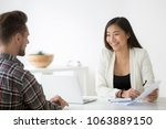 friendly asian hr smiling... | Shutterstock . vector #1063889150