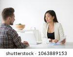 serious asian businesswoman... | Shutterstock . vector #1063889153