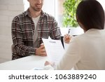 hr manager reading smiling... | Shutterstock . vector #1063889240