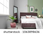 stylish room interior with... | Shutterstock . vector #1063898636
