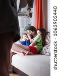 Small photo of Drunk father and frightened children trying to hide. Domestic violence, abused child.