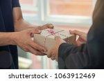 man customer hand accepting... | Shutterstock . vector #1063912469