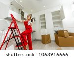 girl in red overalls with drill ... | Shutterstock . vector #1063916666