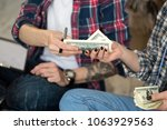 young couple counting money... | Shutterstock . vector #1063929563