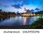 beautiful white mosque by the... | Shutterstock . vector #1063950296
