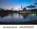 beautiful white mosque by the... | Shutterstock . vector #1063950299