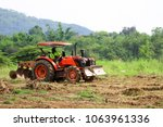 agricultural workers with... | Shutterstock . vector #1063961336