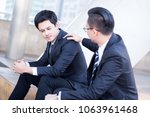 Small photo of Businessman encouraging their partner