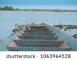 A Wooden Abandoned Boat In The...
