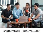 team of four dedicated... | Shutterstock . vector #1063968680