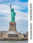 the statue of liberty in new... | Shutterstock . vector #1063982390