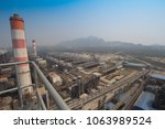 chimneys of coal fired power... | Shutterstock . vector #1063989524