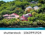 colorful houses on tortola | Shutterstock . vector #1063991924
