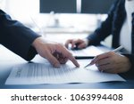 female hand signing contract.   Shutterstock . vector #1063994408