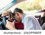 drunk asian young man drives a... | Shutterstock . vector #1063998809