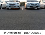 cars parked in the parking lot. ... | Shutterstock . vector #1064005088