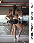 fitness woman weight lifting... | Shutterstock . vector #1064013560