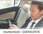 business man working on... | Shutterstock . vector #1064013578