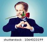 hansome boy wearing a black... | Shutterstock . vector #1064023199