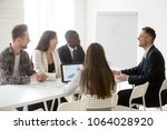 smiling ceo talking to... | Shutterstock . vector #1064028920