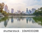skyline view from lumpini park  ... | Shutterstock . vector #1064033288