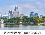 skyline view from lumpini park  ... | Shutterstock . vector #1064033294
