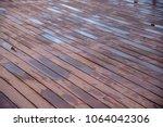 the walkway is a wooden floor.... | Shutterstock . vector #1064042306