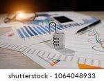 financial analysis unlock... | Shutterstock . vector #1064048933