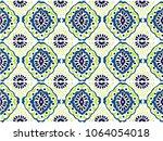 ikat geometric folklore... | Shutterstock .eps vector #1064054018