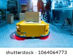 warehouse robot assembly in... | Shutterstock . vector #1064064773