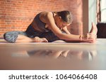 young girl in lotus pose in... | Shutterstock . vector #1064066408