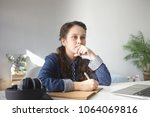 thoughtful 12 year old teenage...   Shutterstock . vector #1064069816