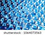 water blue gel balls. polymer... | Shutterstock . vector #1064073563