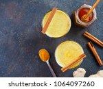 healthy drink golden turmeric... | Shutterstock . vector #1064097260