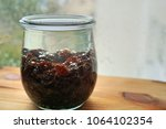 Small photo of raisins in a transparent glass. soaked. for further processing