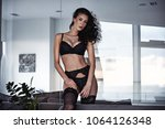 sensual young woman in a... | Shutterstock . vector #1064126348