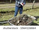 teenage boy throwing dried tree ... | Shutterstock . vector #1064126864