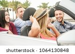 happy friends with hands up... | Shutterstock . vector #1064130848