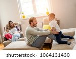 parents with kid playing... | Shutterstock . vector #1064131430