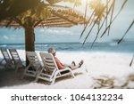 true tilt shift shot an elderly ... | Shutterstock . vector #1064132234