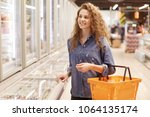 cheerful adorable curly woman... | Shutterstock . vector #1064135174