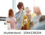two happy women having talk in...   Shutterstock . vector #1064138204